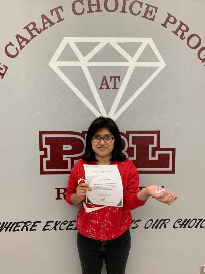 Brandy Garcia Velasquez...Cambridge Scholar Award with Merit